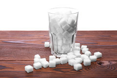 Free A Complete Transparent Glass Of White Refined Sugar On The Table, On A White Background. Royalty Free Stock Image - 96245026