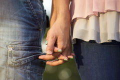 A Couple Holding Hands. Close-up Of Hands Royalty Free Stock Photos