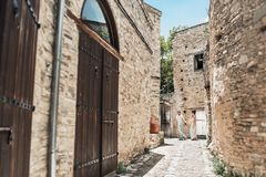 A Couple In Love Walks The Streets Of The Old City Stock Photography