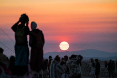 Free A Couple Taking Photos Of The Sunrise On The Playa At Burning Man 2015 Royalty Free Stock Image - 63129026