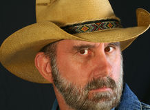 A Cowboy With Slightly Raised Brow Stock Photo