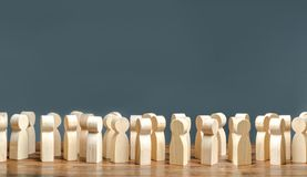 A Crowd Of Wooden Figures Of People. Society, Demography. Group Of Citizens, Rally, Political Movement Or Electorate. Customers Stock Image