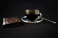 A Cup Of Coffee And A Wallet On A Dark Background Stock Photo