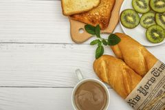 A Cup Of Coffee, Fresh Bread, Toast On A White Woody Background. Morning Breakfast Fresh Bread With A Cup Of Coffee. View From Abo Stock Photos