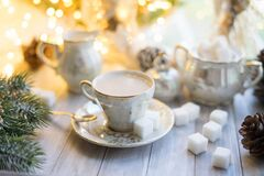 Free A Cup Of English Tea With Milk From An Old Mother-of-pearl Porcelain Service With Refined Sugar. Christmas Tea Party Breakfast On Royalty Free Stock Photo - 199944825