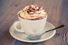 A Cup Of Hot Chocolate With Cream On A Table Stock Photo