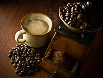 Free A Cup Of Hot Coffee, And An Antique Coffee Grinder Stock Photo - 12500270