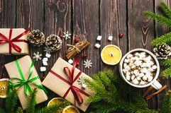 Free A Cup Of Hot Coffee With Marshmallow, Spruce Branches, Cones, Christmas Gifts, Mugs Of Orange, Snowflakes, Cinnamon, New Stock Photography - 128825542