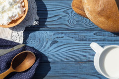 A Cup Of Milk, Cottage Cheese And Bread On A Table Of Blue Board Stock Photography