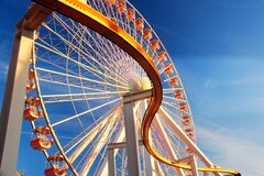Free A Curving Rail Cuts In Front Of A Large Ferris Wheel Royalty Free Stock Image - 182288756