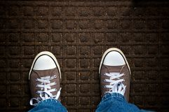 A Dirty Doormat Fills The Image, Looking Down Stock Photo