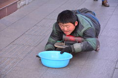 A Disabled Beggar In Beijing Royalty Free Stock Photo