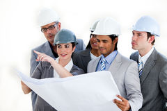 A Diverse Group Of Architects Studying A Plan Royalty Free Stock Image