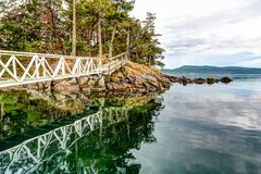 Free A Dock Leading Up To An Island In The Gulf Islands Off The Shores Of Vancouver Island Royalty Free Stock Image - 162019076