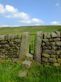 A Dry Stone Wall With Stone Stile Or Narrow Gate With Steps In A Yorkshire Dales Hillside Meadow With A Bright Blue Summer Sky Royalty Free Stock Image