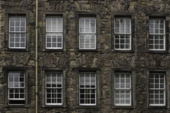 A Facade Of An Old Palace With 2 Rows Of Windows In Edinburgh Old Town Stock Photography