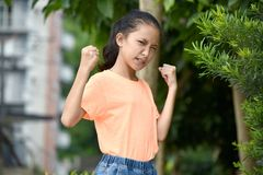 Free A Filipina Female And Muscles Stock Photo - 157977640