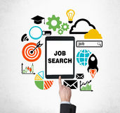 A Finger Is Pushing The Button On The Tablet To Find New Job Vacancies. Looking For A Job In The Internet. Royalty Free Stock Images