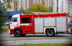 Free A Fire Truck Is Driving An Emergency Call On A Road In The City. Side View Royalty Free Stock Photography - 177964817