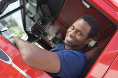 Free A Firefighter Sitting In The Cab Of A Fire Engine Royalty Free Stock Photography - 5948797