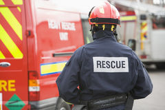 Free A Firefighter Standing By A Small Fire Engine Royalty Free Stock Photography - 5948517
