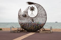 Free A Fish Sculpture On A Beach Filled With Plastic Bottles To Encourage Recycling And Royalty Free Stock Photography - 161312877