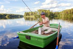 Free A Fisherman In A Boat Royalty Free Stock Photography - 101201727