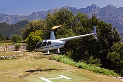 Free A Flying Helicopter In A Beautiful Garden Of A Luxury Hotel In Italy Royalty Free Stock Photography - 100834197