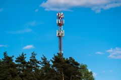 Free A Fragment Of A Cell Tower Close-up Against The Blue Sky.Modern Telecommunication Equipment.4G Networks Stock Photo - 149196500