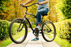 A Fragment Of A Young Man Sitting On The Bike Royalty Free Stock Image