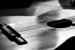 A Fragment Of An Acoustic Guitar Lit By The Sun. Black And White Stock Photography