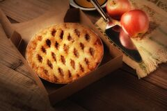 Free A Fresh Apple Pie In A Bakery Box On A Rustic Wood Table With Plate, Serving Utensil And Fresh Fuji Apples Ans Warm Side Light Stock Photo - 197003270