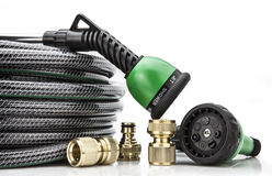 Free A Garden Hose With A Sprayer Royalty Free Stock Photography - 30732547