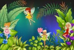 A Garden With Four Fairies Stock Photo