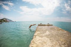 Free A Girl In A Swimsuit Is Standing On The Pier. Royalty Free Stock Photography - 122830017