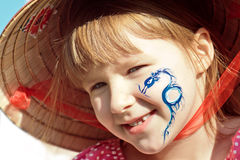 A Girl In Hat With The Dragon On Her Face Royalty Free Stock Photos