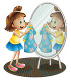 A Girl Looking At The Mirror With Her Dress Stock Photography