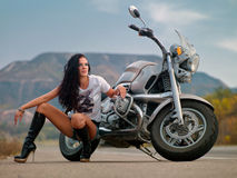 A Girl Near The Bike Royalty Free Stock Image
