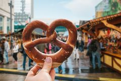 Free A Girl Or A Young Woman Is Holding A Traditional German Pretzel. Stock Photography - 123214742