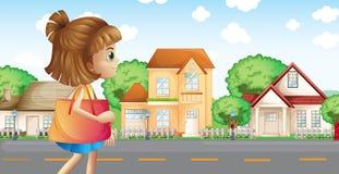 A Girl Walking Across The Neighborhood Royalty Free Stock Photo