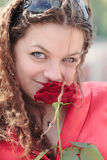 A Girl With A Smile And A Rose Royalty Free Stock Image