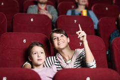Free A Girl With Mother At The Cinema Royalty Free Stock Images - 25010029