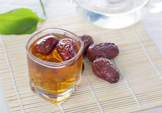 A Glass Cup Of Chinese Red Date Tea On The Table. Royalty Free Stock Image
