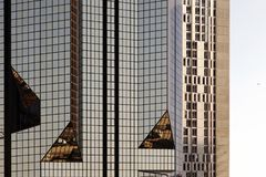 Free A Glass Modern Building With Geometric Angles And Reflection Stock Photography - 103292142