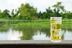 A Glass Of Beer With Ice Beside Thailand River Stock Photos