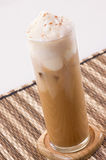 A Glass Of Ice Coffee With Cream Stock Images