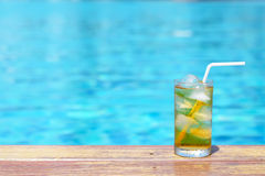 A Glass Of Ice Tea At Pool With Vintage Filter Background Royalty Free Stock Photos