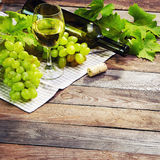A Glass Of White Wine And Grape On Old Wooden Table Royalty Free Stock Image