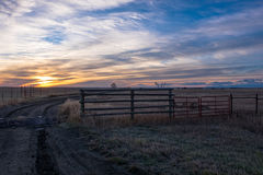Free A Golden Sunrise Rising Over A Rancher& X27;s Field With Colorful Skies Royalty Free Stock Photos - 95986008
