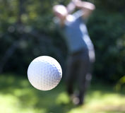 A Golf Ball In Flight Royalty Free Stock Images